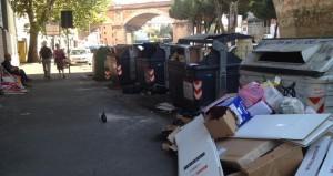 rifiuti e mendicante