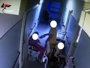 Un fermo immagine tratto da un video dei carabinieri mostra un momento delle violenze nei confronti di un disabile. L'operazione dei militari dell'Arma ha portato alla sospensione di 14 operatori dell'Aias di Decimomannu, Cagliari
