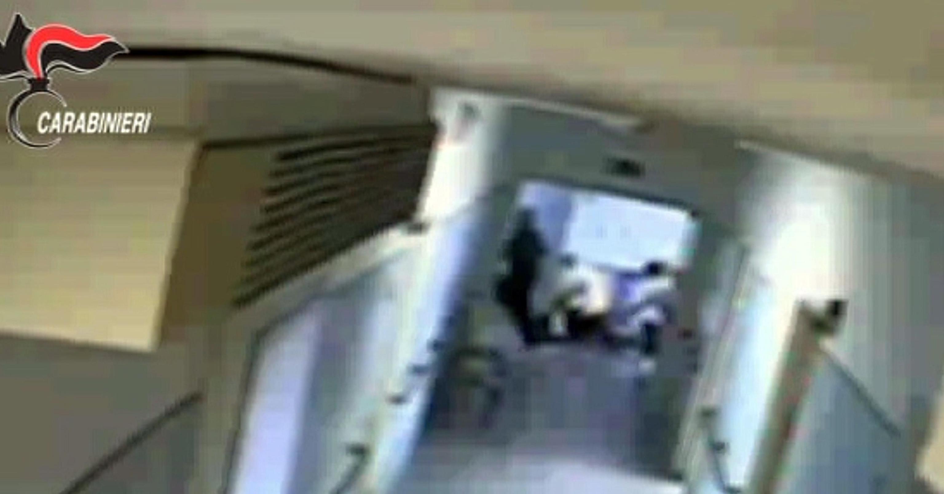 Nel fermo immagine tratto da un video dei carabinieri ripreso da una telecamera nascosta si vedono i gesti di violenza verso un disabile. Per questi maltrattamenti i carabinieri hanno sospeso 14 operatori dell'Aias di Decimomannu in provincia di Cagliari