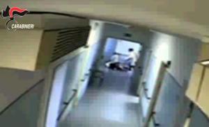 Un fermo immagine tratto da un video dei carabinieri mostra un momento dell'operazione che ha portato alla sospensione di 14 operatori dell'Aias di Decimomannu, Cagliari, accusati di aver maltrattato alcuni spastici ospitati nella struttura.