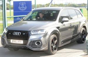 Rooney alla guida della sua vettura
