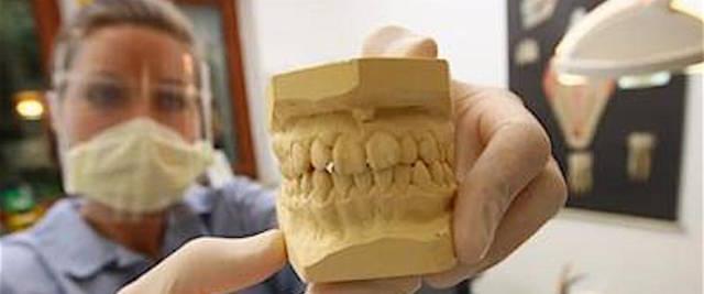 falso dentista cinese