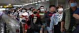 Coronavirus, cinesi in aeroporto si proteggono dal virus con le mascherine