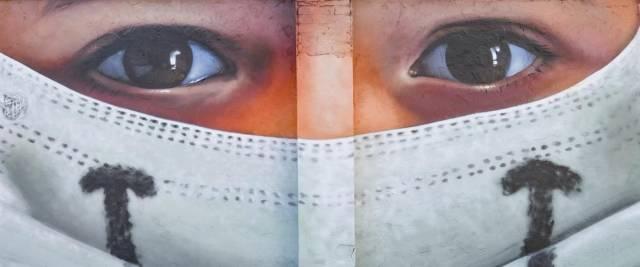 La mascherina non fa male, in onore dei lavoratori dell'ospedale Sacco foto Ansa murales